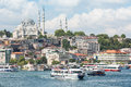 Mosque with minarets in the background of a large number of houses istanbul jul ships and river on july istanbul turkey this Royalty Free Stock Images