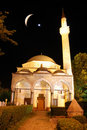 Mosque in night with crescent and star above Stock Photos