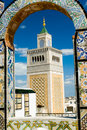 Mosque tower - framed with ornamental arch in Tunis Stock Images
