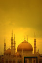 Mosque tower minaret of a at sunset Stock Photos