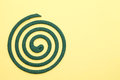 Mosquito coil green on yellow background Royalty Free Stock Photos