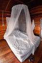 Mosquito net on the bed Royalty Free Stock Photos