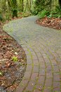 Mossy curved brick path Stock Photo