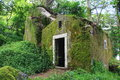 Mossy hut small overgrown with moss Stock Photography