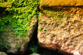 Mossy rock texture textural details of a close up imagery Royalty Free Stock Image
