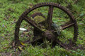 Mossy rusted cog wheel moss covered remains of Royalty Free Stock Photography