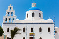 The most famous church on Santorini Island,Crete, Greece. Bell tower and cupolas of classical orthodox Greek church Royalty Free Stock Photo