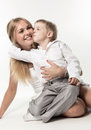 The most favourite boy embraces and kisses woman Stock Images
