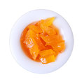Mostarda di frutta chips of deep orange apricot mustard in small white round dish isolated on a white background Royalty Free Stock Images