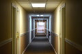 Motel hall a long empty hallway with bands of light and closed doors Stock Photo
