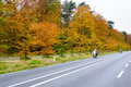 Moterbikes driving on country road bikes autumn scene low angle motion blur Stock Image
