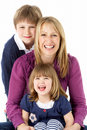 Mother With 2 Young Children In Studio Stock Images