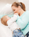 Mother and adorable baby with feeding-bottle Stock Images