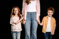 Mother with adorable redhead children standing together and holding hands Royalty Free Stock Photo