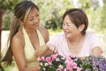 Mother With Adult Daughter Gardening Together Stock Photo