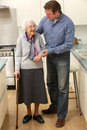 Mother and adult son in kitchen Royalty Free Stock Images