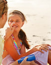 Mother applying sun cream of daughter's nose Royalty Free Stock Photography