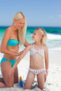 Mother applying sun cream on her daughter's back Royalty Free Stock Photo