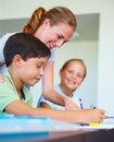 Mother assisting her children in their homework Stock Images