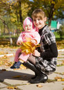 image photo : Mother with  baby  in autumn