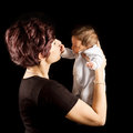 Mother and baby the beauty of motherhood cute parent holding Royalty Free Stock Photos