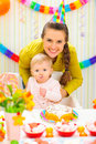 Mother and baby on birthday celebration party Stock Photos
