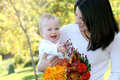 Mother and Baby Boy with Flowers - Fall Theme Stock Image