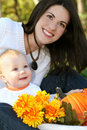 Mother and Baby Boy with Flowers - Fall Theme Stock Images