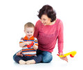 Mother baby boy having fun musical toys white background Stock Photos