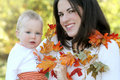 Mother and Baby Boy with Leaves - Fall Theme Royalty Free Stock Photos