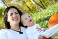 Mother and Baby Boy with Pumpkin - Fall Theme Royalty Free Stock Photography