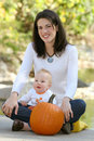 Mother and Baby Boy with Pumpkin - Fall Theme Stock Photo