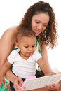 Mother and Baby Boy Reading Book Together Stock Photo