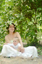 Mother and baby boy young beautiful women in flower crown with her son Royalty Free Stock Images