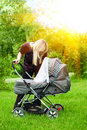Mother with baby carriage Royalty Free Stock Photography