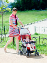 Mother with baby-carriage Royalty Free Stock Photo