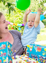 Mother with baby celebrating birthday Stock Photos