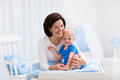 Mother and baby on changing table Royalty Free Stock Photo