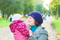 Mother and baby daughter in the park, autumn Stock Photography