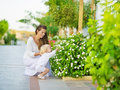 Mother and baby discover vegetable life outdoors Royalty Free Stock Photo