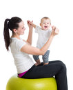 Mother and baby do gymnastics on ball with gymnastic Royalty Free Stock Image