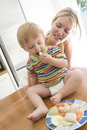 Mother and baby eating fruit and vegetables Royalty Free Stock Image