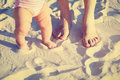 Mother and baby feet on summer beach sand Stock Photography