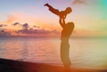 Mother and baby fun at sunset beach Royalty Free Stock Photo