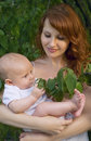 Mother with a baby in a garden Royalty Free Stock Image