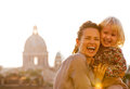 Mother and baby girl against rome panorama Royalty Free Stock Photo