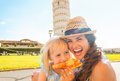 Mother and baby girl eating pizza in pisa Royalty Free Stock Photo