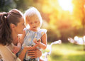Mother and baby girl having fun outdoors Royalty Free Stock Photo