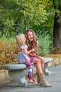 Mother and baby girl having fun time in city park happy Royalty Free Stock Photography