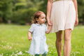 Mother with baby girl walking at summer park Royalty Free Stock Photo
